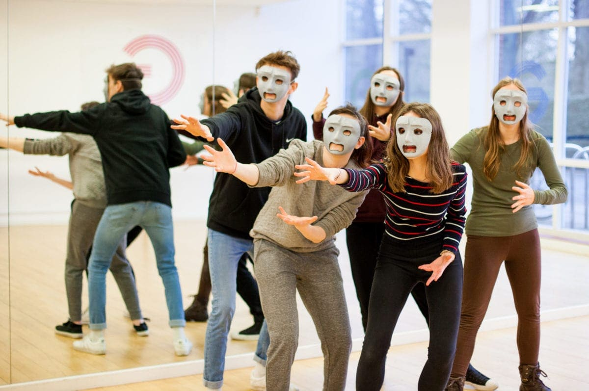 GCSE Drama students acting in masks