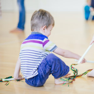 Toddler playing in a class