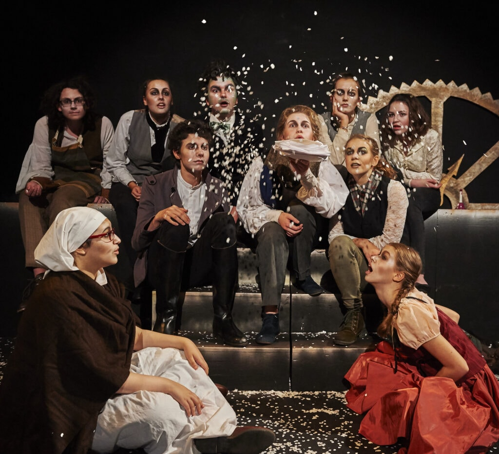 Group of young people on stage acting