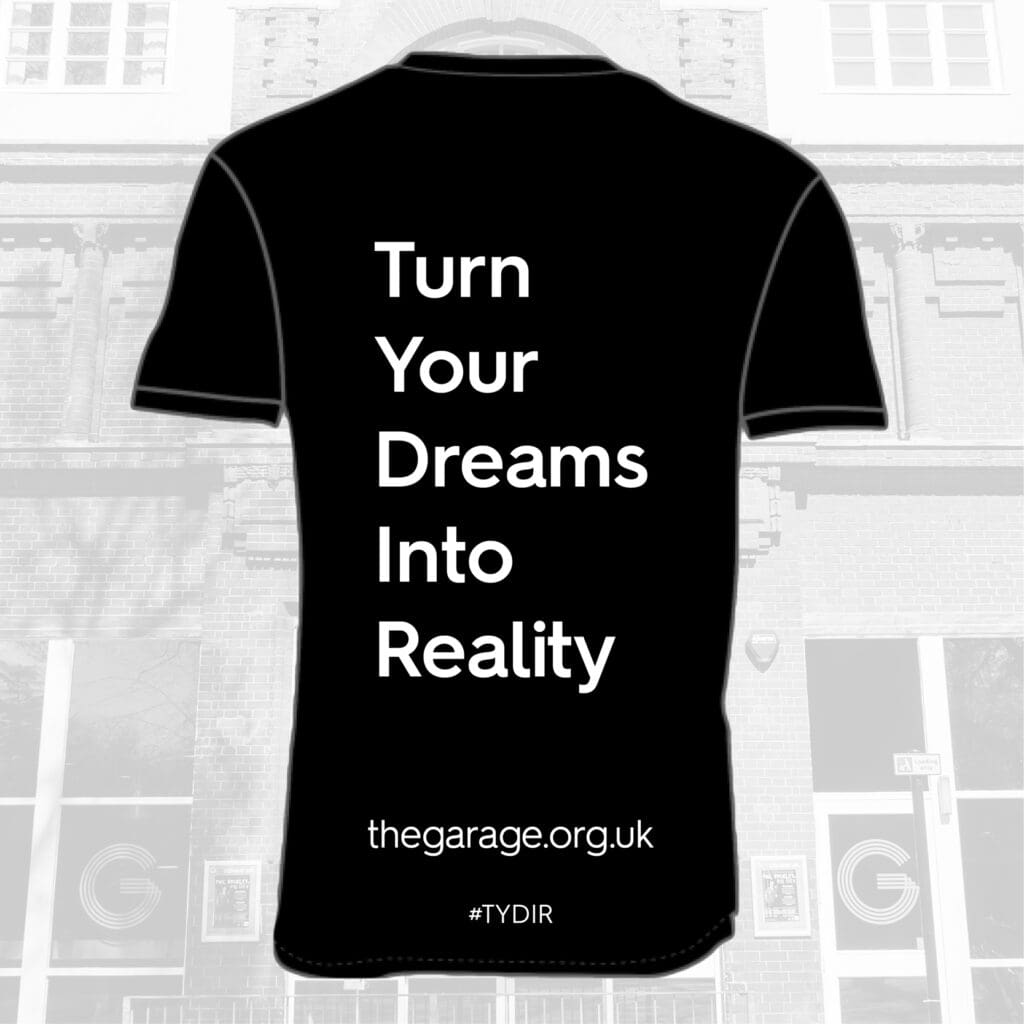 A black t-shirt with the words Turn Your Dream Into Reality on it