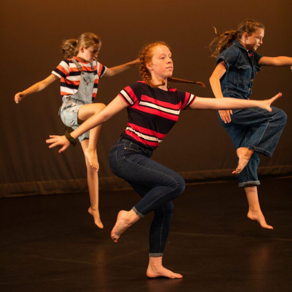 Three young girls dancing on stage